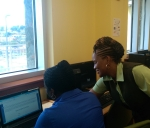 Tia Liburd of GERS assists client during GERS Self-Help Week at Turnbull Library PCC