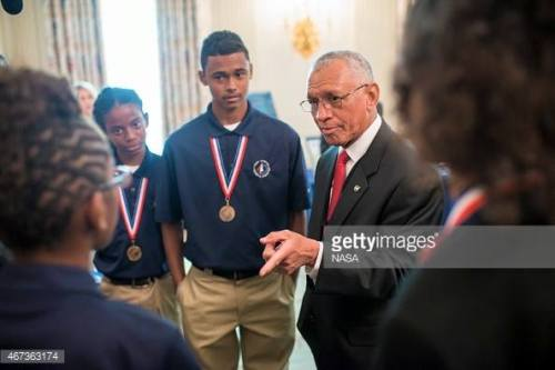 WASHINGTON, DC - MARCH 23: NASA Administrator Charles Bolden speaks with members of Team Caribbean Splash, from Elena L. Christian Jr. High School in the U.S. Virgin Islands, at the fifth White House Science Fair March 23, 2015 in Washington, DC. In addition to competing in the national finals of the Team America Rocketry Challenge: Stephanie Bullock, 16; Shimeeka Stanley, 15; Gabriel St. Kitts, 13; Maria Heywood, 13; and Amari DeSouza, 12; submitted one of five proposals selected to participate in the Small Satellites for Secondary Students (S4) Payload Contest which will be held in Nevada this June. (Photo by Joel Kowsky/NASA via Getty Images)