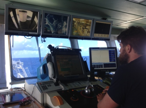 View from the bridge with Matt Foley at the helm. Approaching St Croix. Cameras show (L to R): cable unspooling in the hold; cable deploying off stern; tractors pulling the cable out of hold; ship's course.