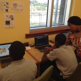 Turnbull Library PCC Volunteer Nneka Byron helps a young man create another line of code