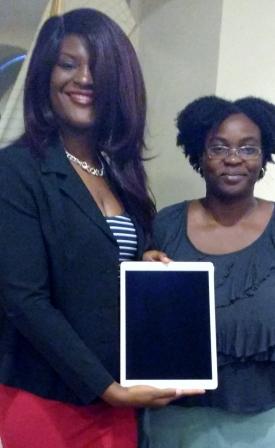 iPad Pro winner Markida Scotland (IG: @localladymedia) receives her gift from viNGN's Rochelle Lewis