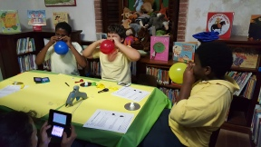 "File photo: Children create hovercrafts from balloons and CDs in a ""makerspace"" at Sprauve Public Library PCC (March 2016)"