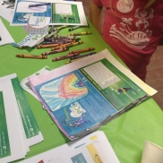 """A youngster colors in viNGN mascot """"Fiber Freddy"""" at Sprauve Public Library PCC Open House"""