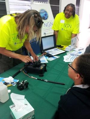 Pam Woodward demonstrates fiber optic splicing