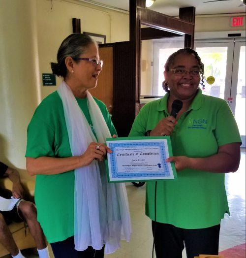 Resident PCC Volunteer Jean Mukti Kuster receives certificate of training from viNGN's Anita Davis