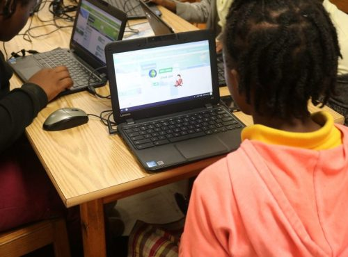 student at laptop doing hour of code